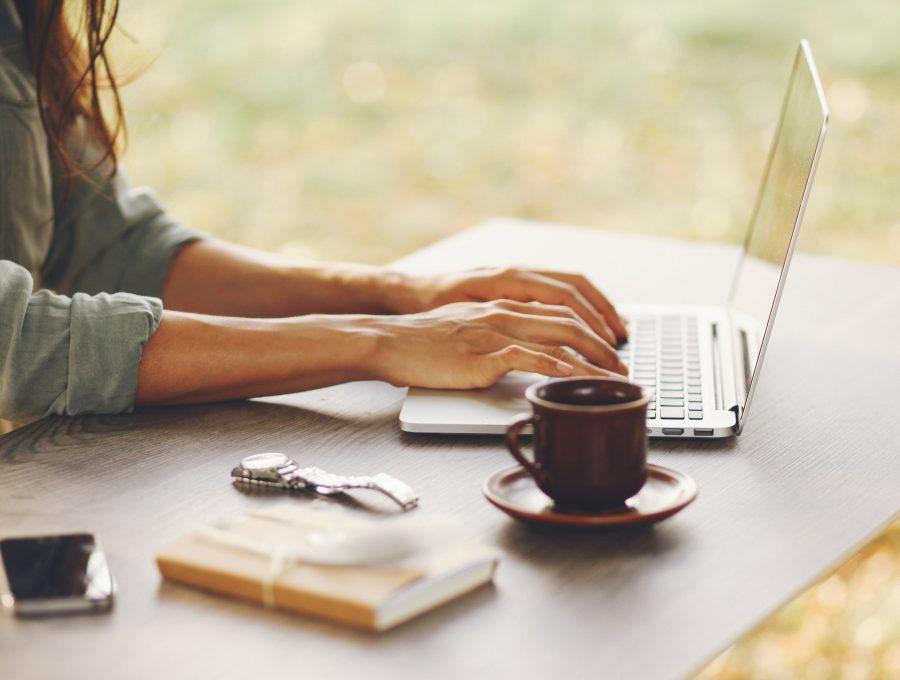 Female novelist writing on her laptop